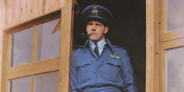 A colorized version of a photo of Alastair Gunn relaxing in the dispersal doorway at RAF Benson in late summer 1941.