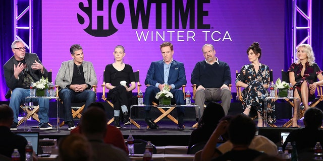 (L-R) Executive producer & creator Brian Koppelman, executive producer creator David Levien, actors Asia Kate Dillon, Damian Lewis, Paul Giamatti, Maggie Siff and Malin Akerman of the television show 'Billions.'