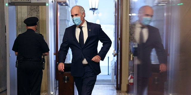 WASHINGTON, DC - MAY 18: Wearing a face mask to reduce the chance of transmission of the novel coronavirus, Sen. Robert Casey (D-PA) arrives at the U.S. Capitol for a vote May 18, 2020 in Washington, DC. The Senate is back in session during the COVID pandemic for a procedural vote on the nomination of Scott Rash to serve as federal district judge in Arizona. (Photo by Chip Somodevilla/Getty Images)