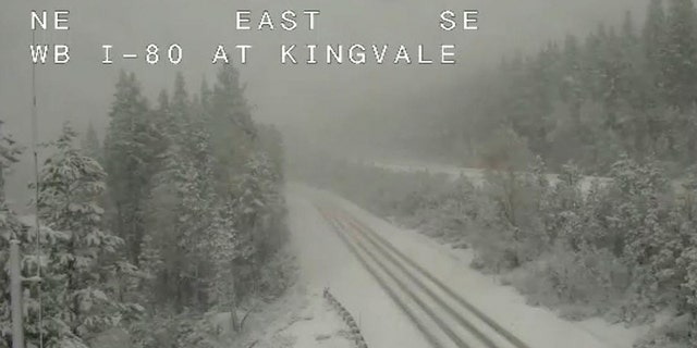 In this still image taken from a Caltrans remote video traffic camera, snow is seen along Interstate 80 near Truckee, Calif., May 18.