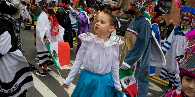 A young girl is seen participating in a Cinco de Mayo parade in New York City in 2018.