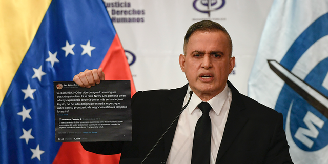 Venezuela's Attorney General Tarek William Saab holds up twitter posts during a press conference regarding what the government calls a failed attack over the weekend aimed at overthrowing President Nicolás Maduro in Caracas, Venezuela, May 4. The twitter posts are between two members of the opposition, Humberto Calderon and Yon Goicoechea. (AP Photo/Matias Delacroix)