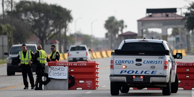 Police officers stand at a checkpoint after a shooting incident at Naval Air Station Corpus Christi, Texas, U.S. May 21, 2020.