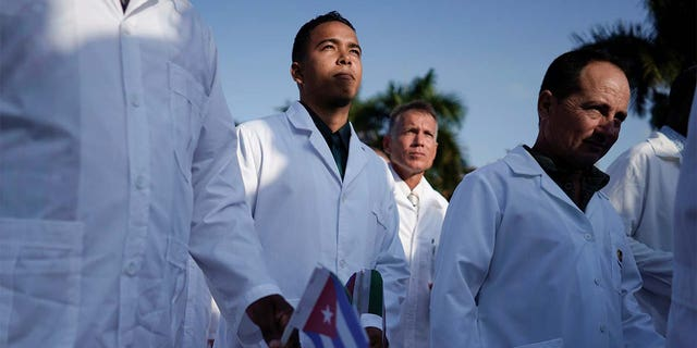 Cuban doctors take part in a farewell ceremony before departing to Italy to assist, amid concerns about the spread of the coronavirus disease (COVID-19) outbreak, in Havana, Cuba.