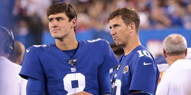 New York Giants quarterback Daniel Jones (8) looks on with quarterback Eli Manning (10) during the second half against the Chicago Bears at MetLife Stadium Aug 16, 2019.