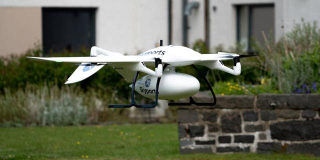 Skyports delivery drone manufactured by Wingcopter in-flight. Supplies are transported in the container beneath the drone - file photo.