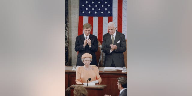 Queen Elizabeth II is applauded by Vice President Dan Quayle and House Speaker Thomas Foley before her address to the U.S. Congress on Thursday, May 16, 1991 in Washington. (AP Photo/Doug Mills)