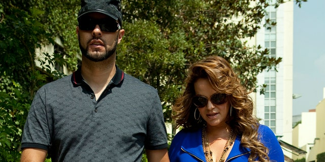 File picture taken on June 14, 2011, of Mexican-American singer Jenni Rivera, walking with her then boyfriend, baseball player Esteba Loaiza. Rivera died in a plane crash on December 9, 2012. AFP PHOTO (Photo credit should read STR/AFP via Getty Images)