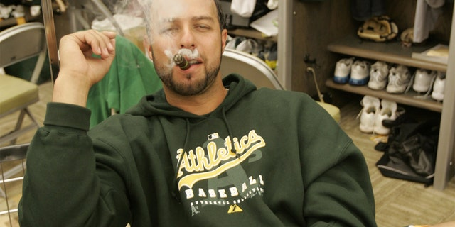 OAKLAND, CA - APRIL 14: Esteban Loaiza of the Oakland Athletics smokes a cigar in the clubhouse before the game against the New York Yankees at the McAfee Coliseum in Oakland, California on April 14, 2007. (Photo by Michael Zagaris/MLB Photos via Getty Images)