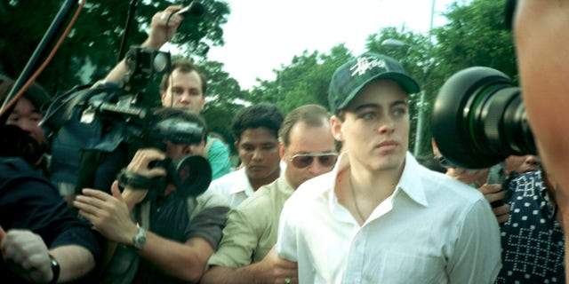 American Michael Fay, 19, accompanied by his father George, behind, leaving the Queenstown Prison in Singapore following his release. (AP Photo/Tan Ah Soon, File)