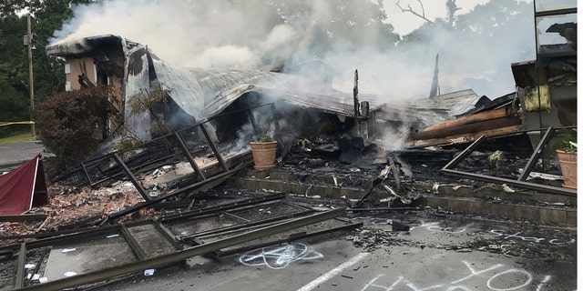 Embers smolder on the remains of the First Pentecostal Church in Holly Springs, Miss., May 20. (Major Kelly McMillen/Marshall County Sheriff's Office via AP)