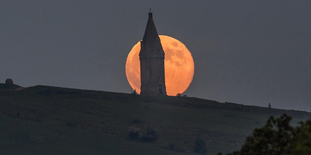 The Full Moon, known in May as the Flower Moon, rises above Hartshead Pike near Ashton-Under-Lyne on May 29, 2018 in Manchester, England - file photo.