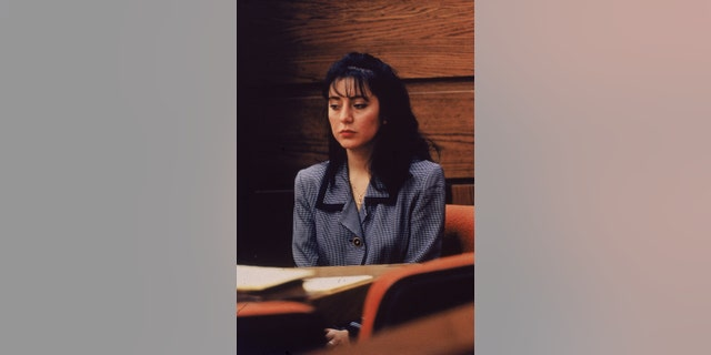 Ecuadorian-born Lorena Bobbitt sits at a table during her trial in Manassas, Virginia, in January 1994. Bobbitt was on trial for cutting off her husband's penis; she was acquitted by reason of temporary insanity.