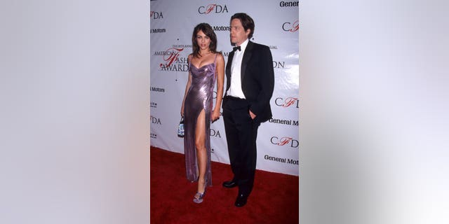 gardening Elizabeth Hurley and Hugh Grant during 18th Annual CFDA Awards at 69th Regiment Armory in New York City, New York.