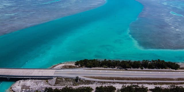 An aerial view shows deserted country road 905 in Key Largo on March 22. (CHANDAN KHANNA/AFP via Getty Images)