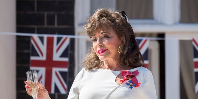 On the 75th anniversary of VE Day Dame Joan Collins leads a 'Nation's Toast' on behalf of the women of the nation who sacrificed so much for their country from her London home on May 8, 2020, in London, England. The UK commemorates the 75th Anniversary of Victory in Europe Day (VE Day) with a pared-back rota of events due to the coronavirus lockdown. On May 8th, 1945 the Allied Forces of World War II celebrated the formal acceptance of surrender of Nazi Germany.