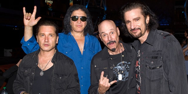 From left, Eric Singer, Gene Simmons, Bob Kulick, and Bruce Kulick backstage at KISS Army Night and jam session at Rocktoberfest at L.A. LIVE on October 18, 2012 in Los Angeles, Calif.聽