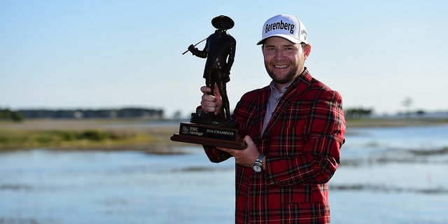Branden Grace of South Africa poses with the trophy after winning the 2016 RBC Heritage at Harbour Town Golf Links on April 17, 2016 in Hilton Head Island, S.C. (Photo by Jared C. Tilton/Getty Images)