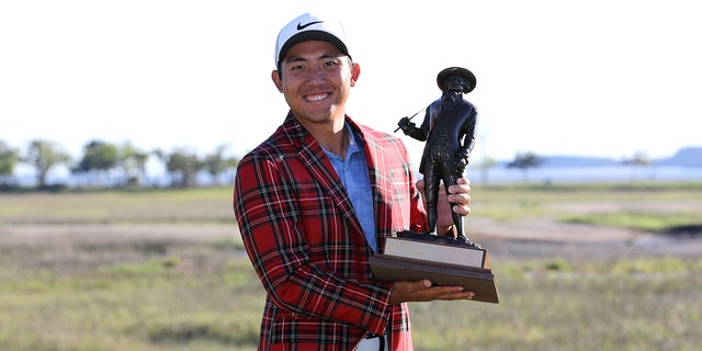 C.T. Pan of Taiwan poses with the trophy after winning the 2019 RBC Heritage at Harbour Town Golf Links on April 21, 2019 in Hilton Head Island, S.C. (Photo by Streeter Lecka/Getty Images)
