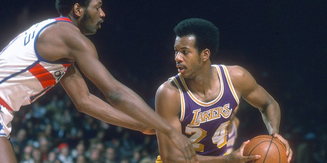 Kermit Washington, #24 of the Los Angeles Lakers, looks to put a move on Elvin Hayes, #11 of the Washington Bullets, during an NBA basketball game circa 1976 at the Capital Centre in Landover, Maryland. Washington played for the Lakers from 1973-77. (Photo by Focus on Sport/Getty Images, File)