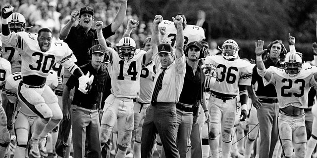 Head coach Pat Dye and the Auburn Tigers celebrate on the sidelines during a game in 1982. (Photo by Collegiate Images via Getty Images)