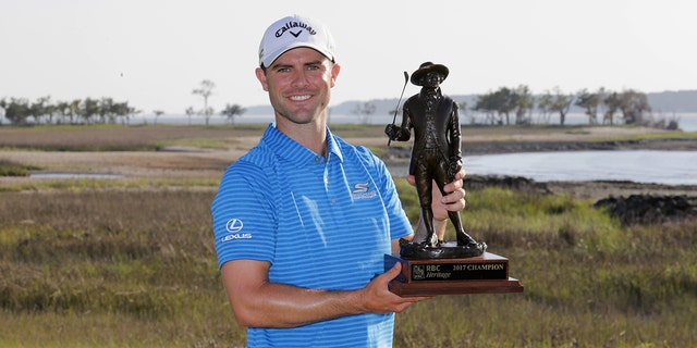 Wesley Bryan celebrates with the trophy after winning the 2017 RBC Heritage at Harbour Town Golf Links during the final round on April 16, 2017 in Hilton Head Island, S.C. (Photo by Streeter Lecka/Getty Images)