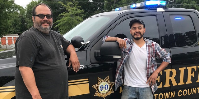To thank the duo, the sheriff鈥檚 office proclaimed them 鈥渉onest men鈥� and posted a picture of them smiling alongside a patrol vehicle. (Courtesy:聽Georgetown County Sheriff's Office)