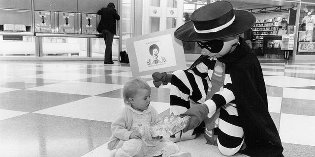 The Hamburglar, seen here in 1991 actually giving away a Happy Meal, was originally introduced in 1971. (Hank DeGeorge/Chicago Tribune/Tribune News Service via Getty Images)