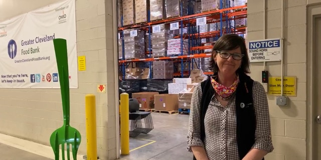 "Kristin Warzocha, President and CEO of Greater Cleveland Food Bank, says they are serving more people than during the recession. ""That happened a little more gradually. This was like hitting a brick wall."""