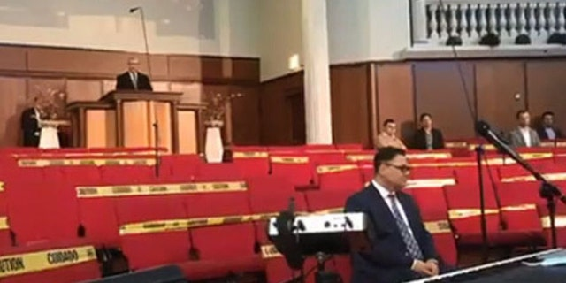 Cristian Ionescu, a senior pastor of Elim Romanian Pentecostal Church in Chicago, Ill., held a service Sunday, May 10, 2020 in defiance of Gov. J.B. Pritzker's stay-at-home orders during the coronavirus pandemic as states begin to reopen. (Liberty Counsel)
