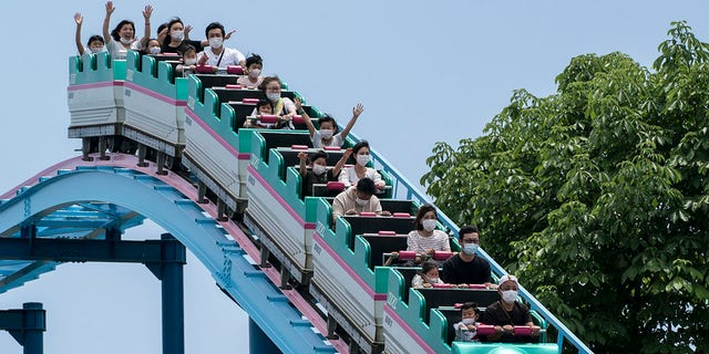 "Visitors and employees at Japan's theme parks are being advised to refrain from making loud or unnecessary noises in order to minimize droplets or ""splashes"" emanating from their mouths."