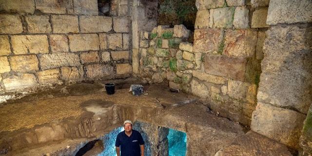 Dr. Barak Monnickendam-Givon at the subterranean system.