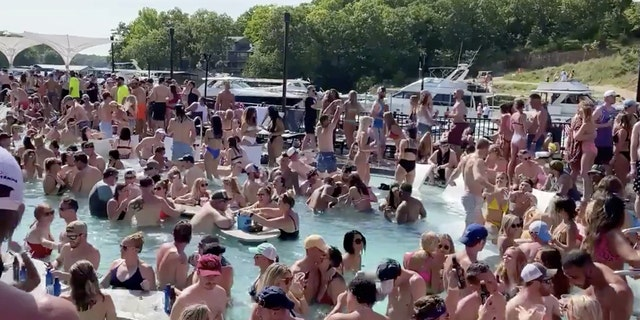 Revelers celebrate Memorial Day weekend at Osage Beach of the Lake of the Ozarks, Missouri, U.S., May 23,  in this screen grab taken from social media video and obtained by Reuters on May 24.