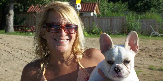 This 2011 Facebook photos shows Lisa Urso with one of her French bulldogs.
