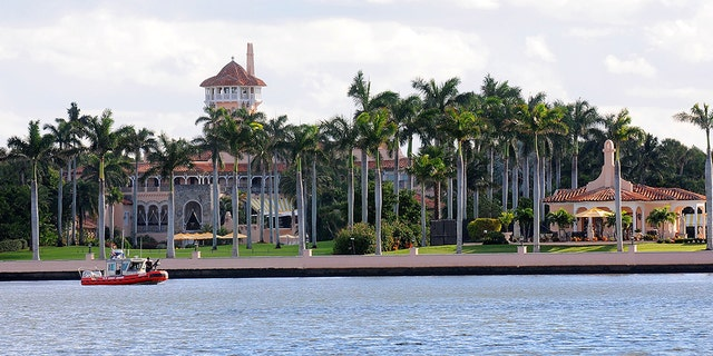 A U.S. Coast Guard boat passes through the Mar-a-Lago Resort (Photo by Gerardo Mora/Getty Images)