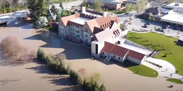 This footage, filmed by Anthony Clark on May 20, shows an aerial view of Floodwaters in Midland, Mich. can be seen on May 20, 2020 after two dams in were overtaken following heavy rainfall, forcing the evacuation of communities downstream.