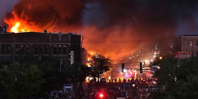 Seen from Hiawatha Avenue, a large fire burns Thursday, May 28, 2020. (David Joles/Star Tribune via AP)