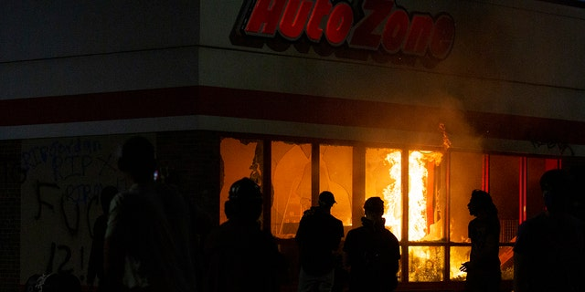 A fire burns in an AutoZone store during a protest Wednesday, May 27, 2020, in Minneapolis against the death of George Floyd in Minneapolis police custody earlier in the week. (Christine T. Nguyen/Minnesota Public Radio via AP)