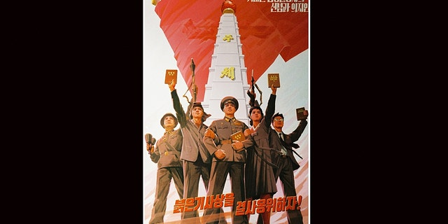 North Korean propaganda urging their citizens to keep the red flag thought, or communism, alive.