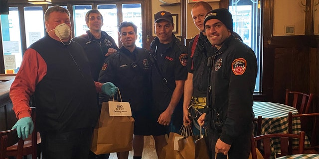 """Mike """"Red"""" Walsh, far left, is using his New York Yankees connections to feed New York City first responders while helping to keep a favorite pub in business during the coronavirus pandemic. (Mike """"Red"""" Walsh)"""