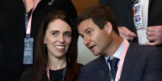 In this Sept. 21, 2019, file photo, New Zealand Prime Minister Jacinda Ardern, left, stands with her fiance Clarke Gayford as they watch rugby in Yokohama, Japan.