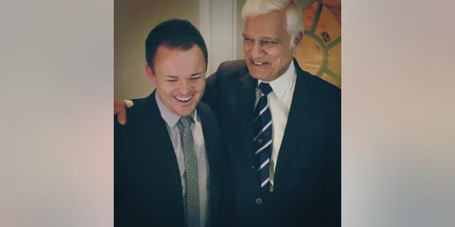 Christian leaders Nick Hall and Ravi Zacharias laugh together.