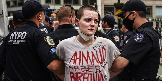 Police detaining a protesters in New York City as tensions escalated over the death of George Floyd. (Stephanie Keith/Getty Images)
