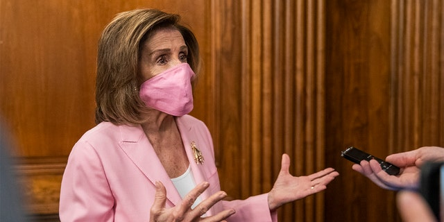House Speaker Nancy Pelosi of Calif., talks to reporters on Capitol Hill, Tuesday, May 5, 2020, in Washington.