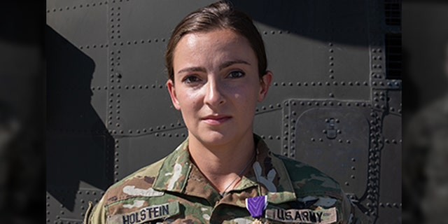 1st Lt. Abigail Holstein was presented the Purple Heart on May 3, 2020, for her injuries sustained during the theater ballistic missile attacks at Al Asad Air Base, Iraq, on January 8, 2020. Of the 27 Soldiers to receive Purple Hearts from the January attacks, 1st Lt. Holstein is one of the few 34th Expeditionary Combat Aviation Brigade recipients to return to duty after receiving initial treatment for her injuries and thus, received the Purple Heart medal in-theater. She serves as an enroute critical care nurse with Charlie Company, 3-238th General Support Aviation Battalion. (U.S. Army photo by Sgt. Sydney Mariette)