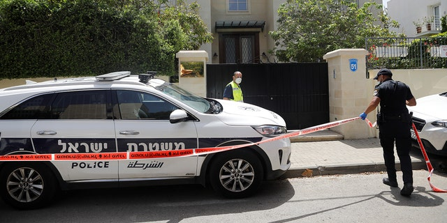 An Israeli policeman cordons off an area near the house of China's ambassador to Israel, Du Wei, in Herzliya, north of Tel Aviv, on Sunday. REUTERS/Nir Elias - RC28QG94RYQO