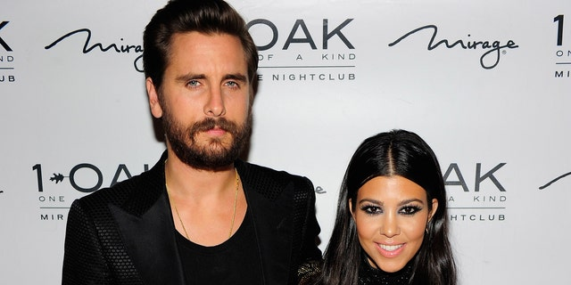 Television personalities Scott Disick (L) and Kourtney Kardashian attend Scott's birthday celebration at 1 OAK Nightclub at The Mirage Hotel & Casino on May 23, 2015 in Las Vegas, Nevada. (Photo by Steven Lawton/FilmMagic)