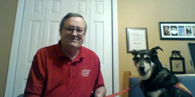 Canines for Christ Chaplain Ron Leonard and his therapy dog Molly.