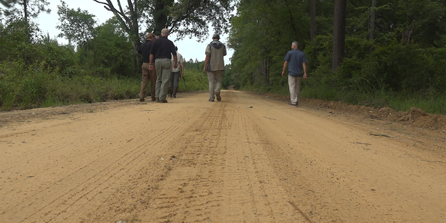 The U.S Geological survey team works to capture Tegu lizards in Reidsville, GA.