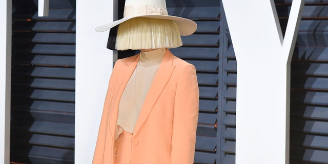 Sia reveals she adopted two teenage sons.